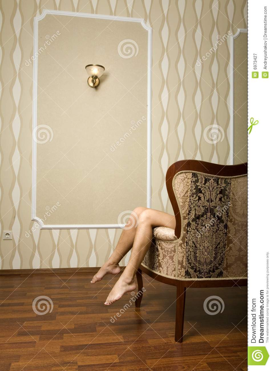 Pair of a Womanu0027s Feet over the Classic King Chair & Pair Of A Womanu0027s Feet Over Classic King Chair Stock Image - Image ...