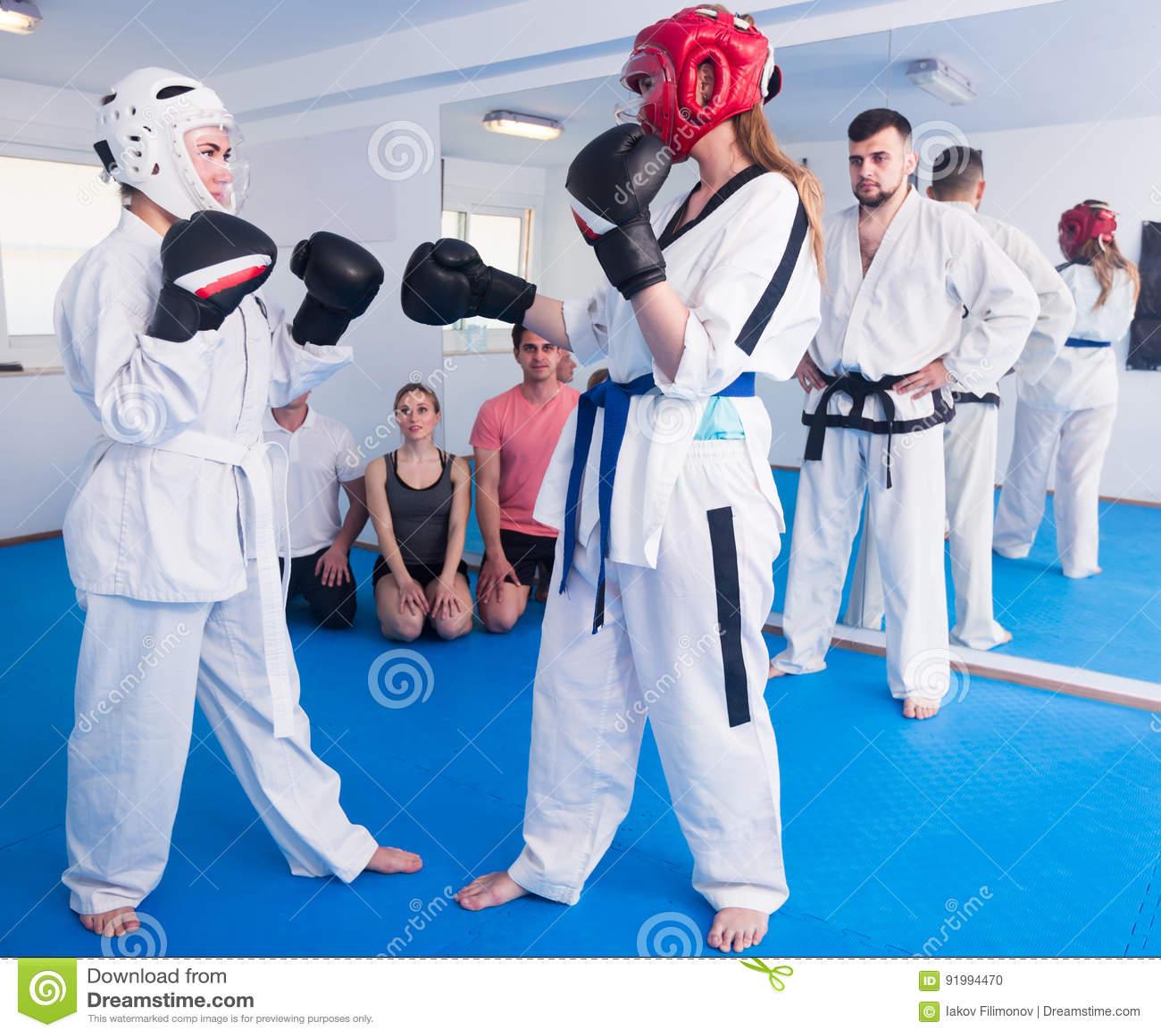 Pair Of Women In Sparring At Taekwondo Stock Photo - Image