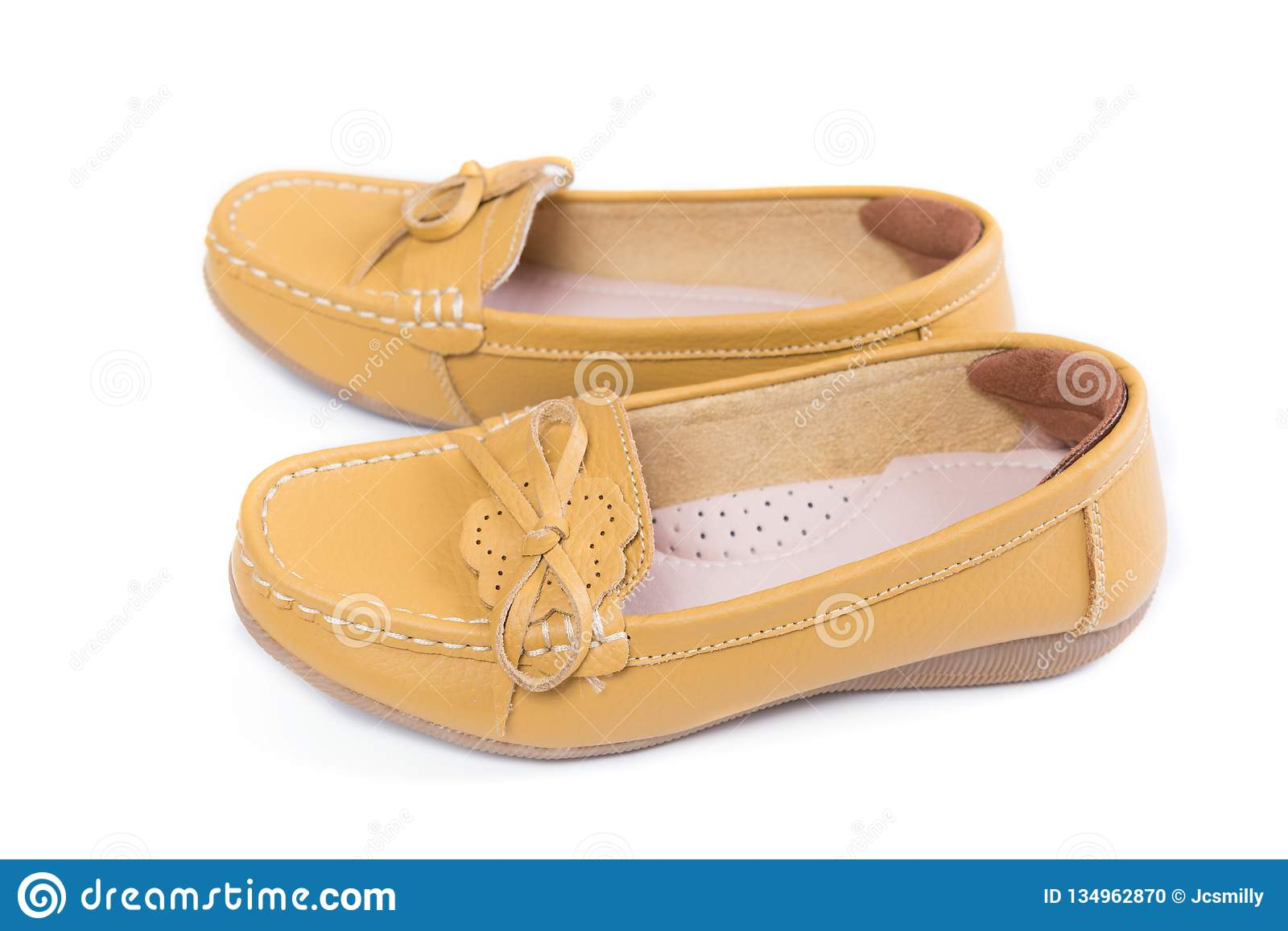 9d40b246e Pair of yellow casual leather flat shoes isolated on white background