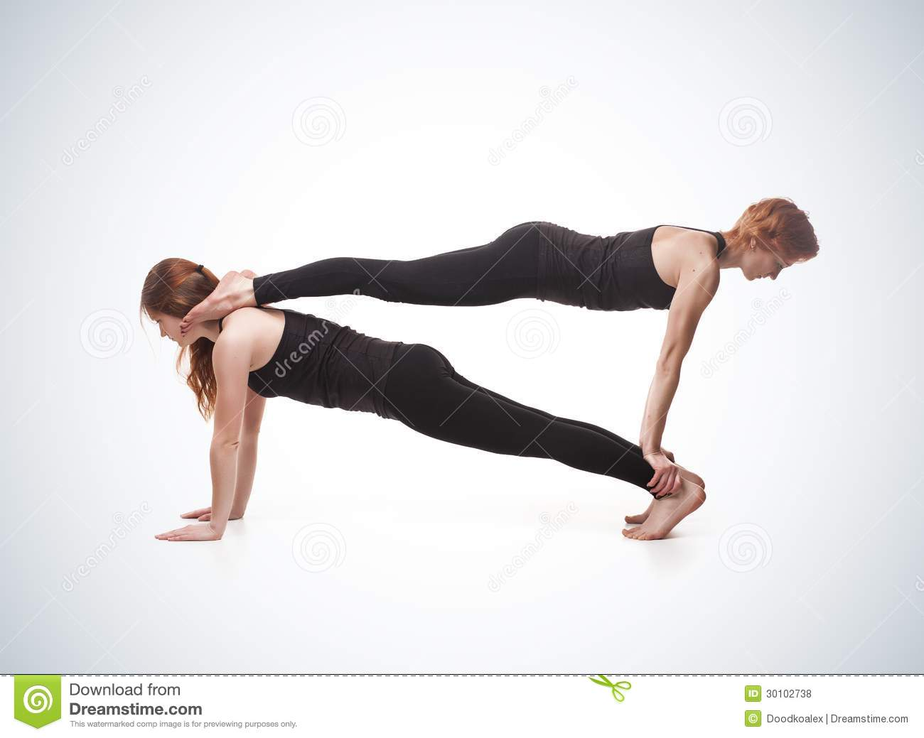 Paired yoga. Two women practicing yoga on blue gradient background.