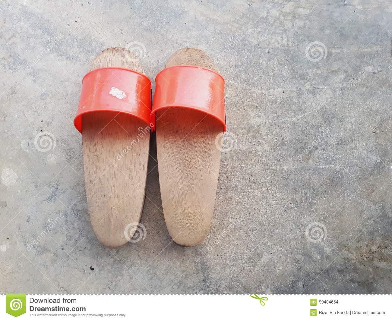 2f1e1a7f6cc4 Pairs of home-made traditional wooden shoes. Wooden clogs are versatile shoes  appear in and out of house in olden days.