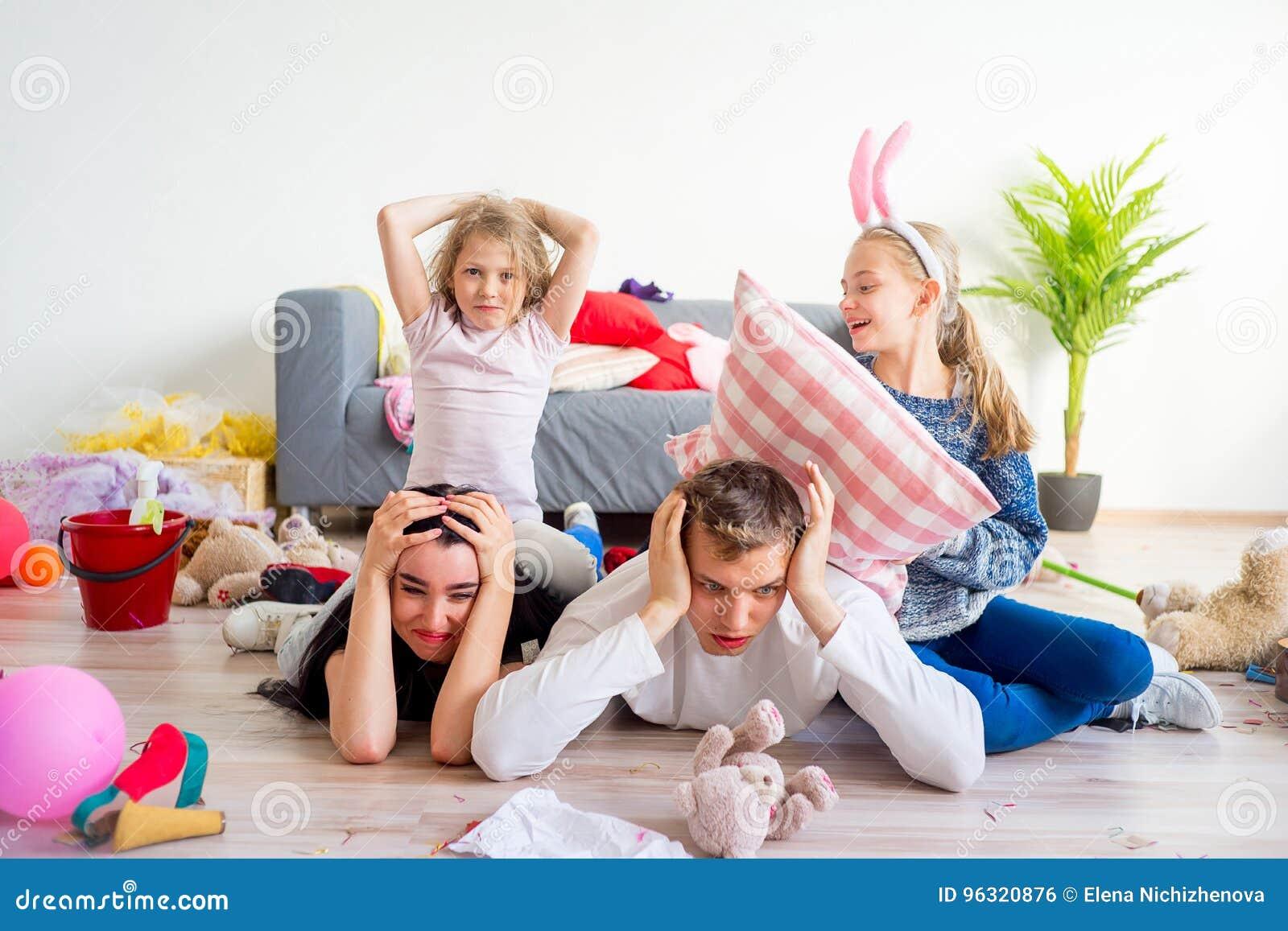 download pais cansados e crianas brincando foto de stock imagem de sorriso caucasiano