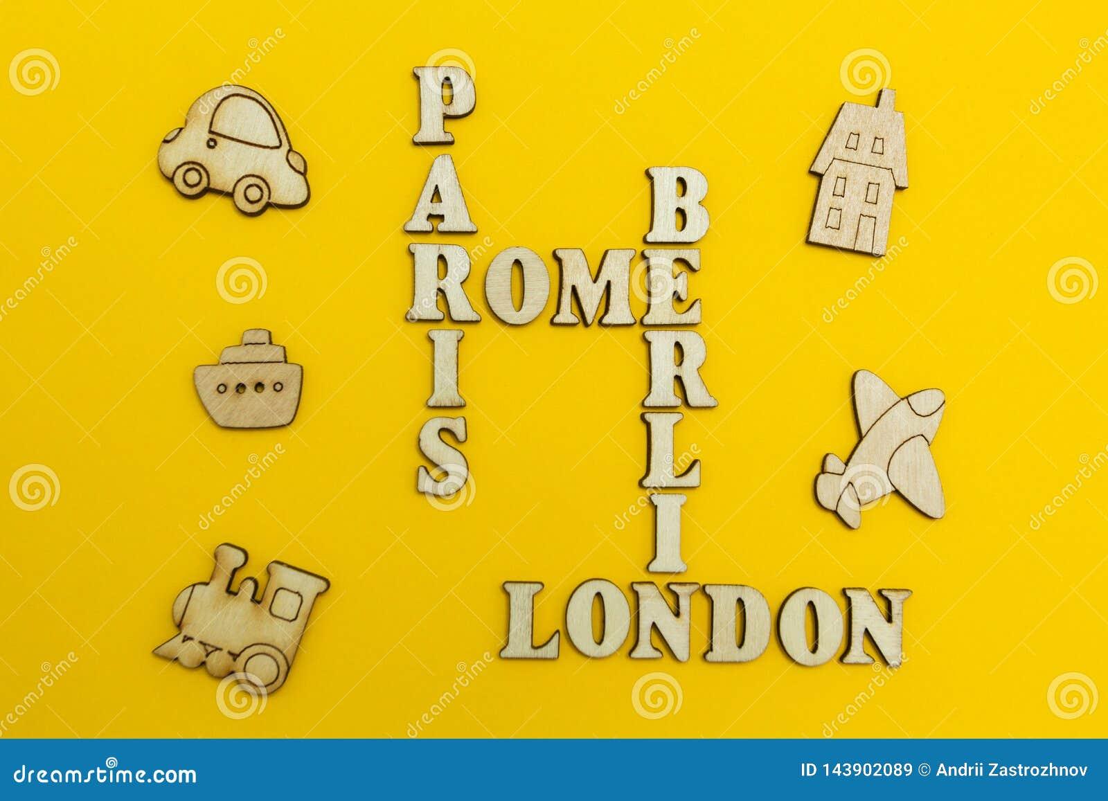 Palavras cruzadas dos nomes das cidades: 'Paris, Londres, Berlim, Roma 'em um fundo amarelo Figuras de madeira de um avião, um tr