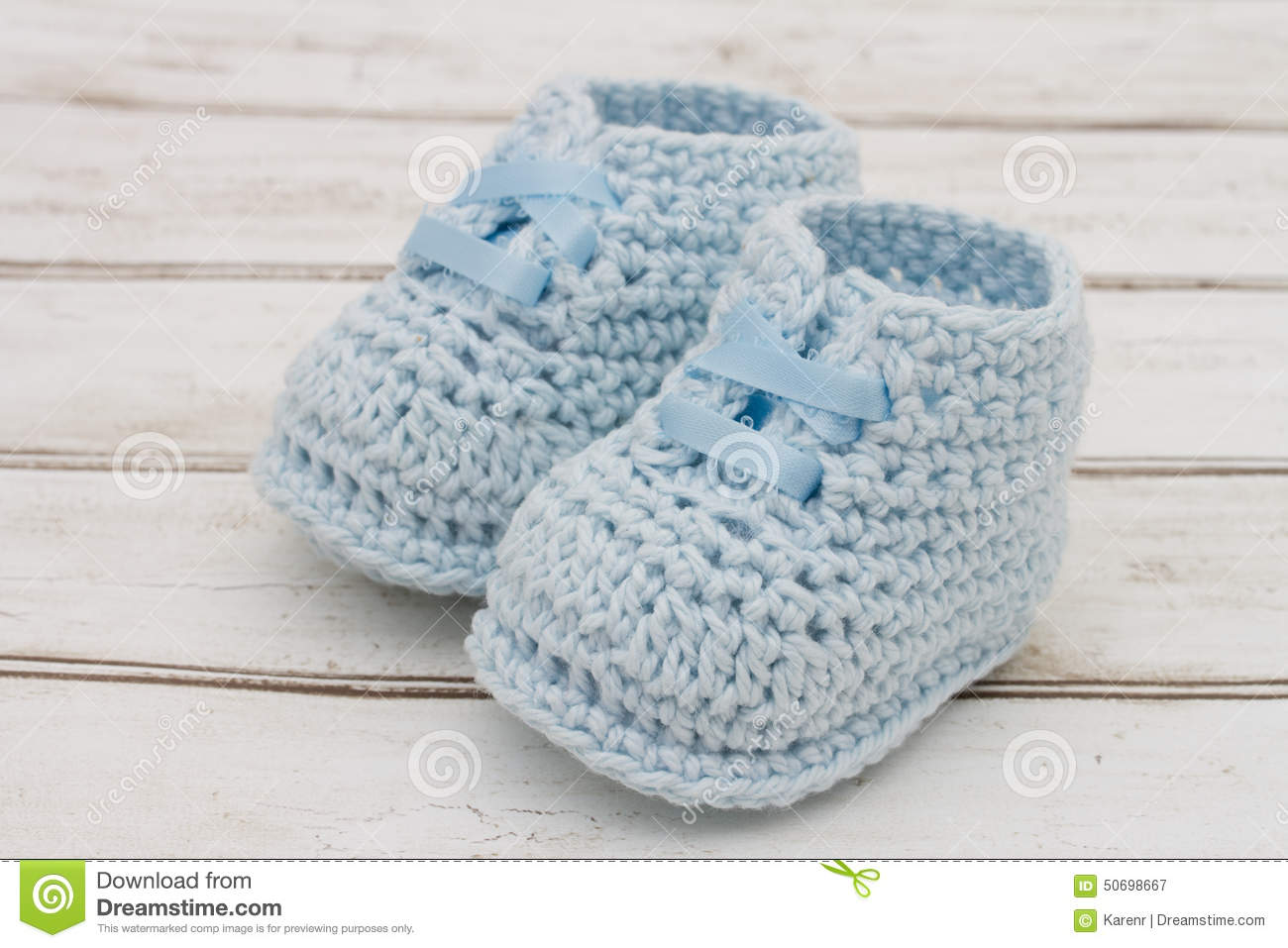 0d0db248c832 Pale Blue Baby Booties On Wood Background Stock Image - Image of ...