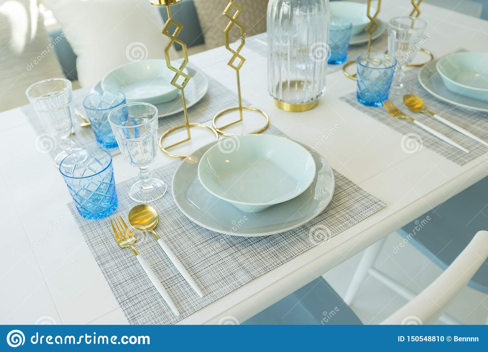Wondrous Pale Blue Plate Setting On Table With Gold Candle Holder In Download Free Architecture Designs Scobabritishbridgeorg