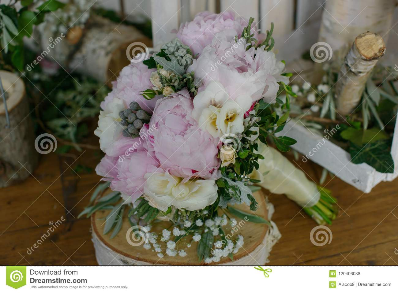 Pale Pink Colored Peonies Freesias And Greenery Bouquet Sitting On Top Of A Rustic Wooden Table Stock Photo Image Of Blossom Arrangement 120406038