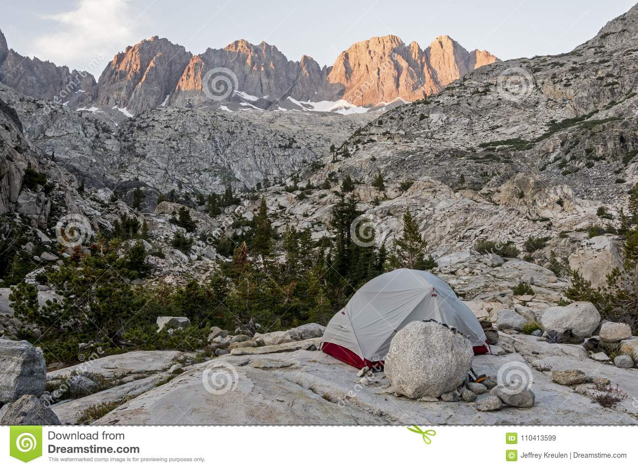 The sun sets on Palisade Crest above a backpackers tent on the John Muir Trail Kings Canyon National Park California. & Palisade Crest Sunset Kings Canyon National Park California Stock ...