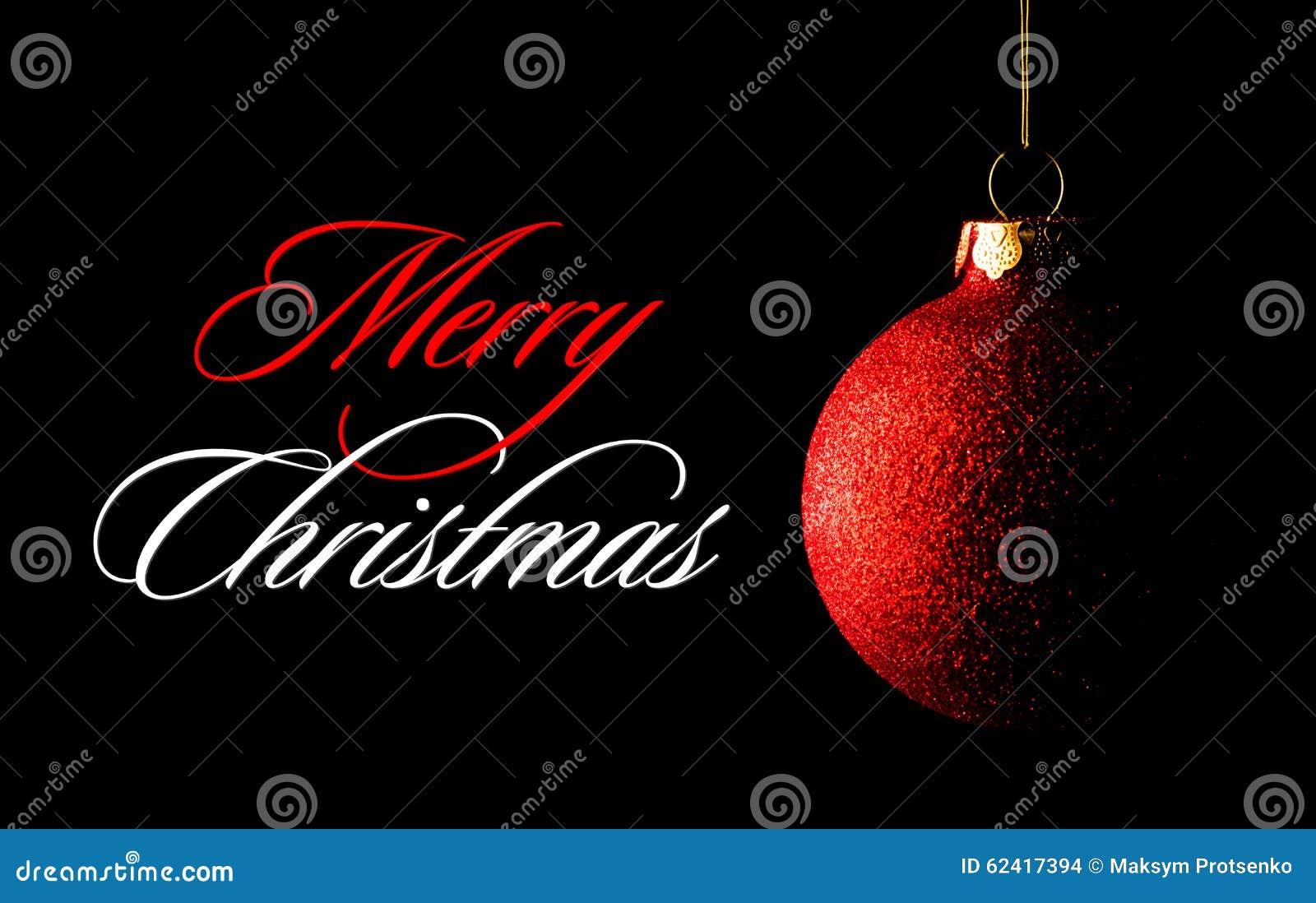 Palla rossa di Natale sui precedenti neri Cartolina d auguri