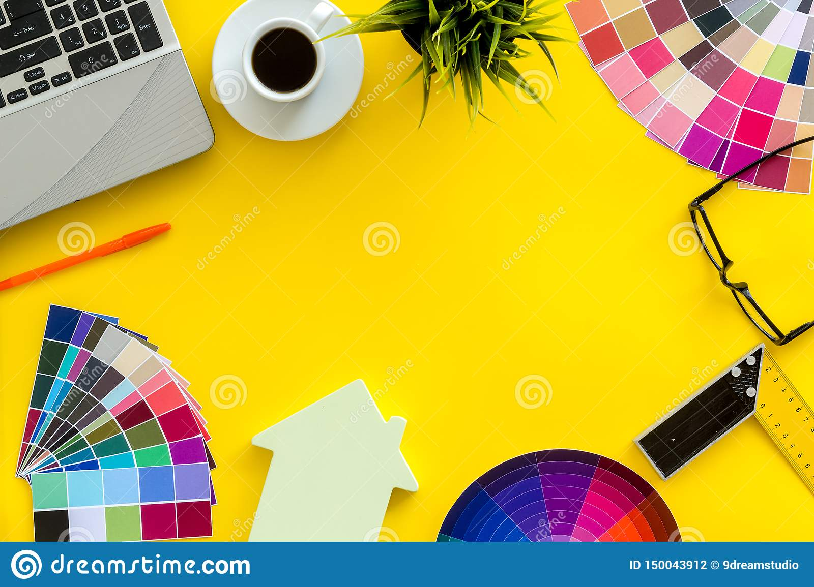 Pallet, laptop, house figure, coffee and tools for architect work on white desk background top view copyspace frame
