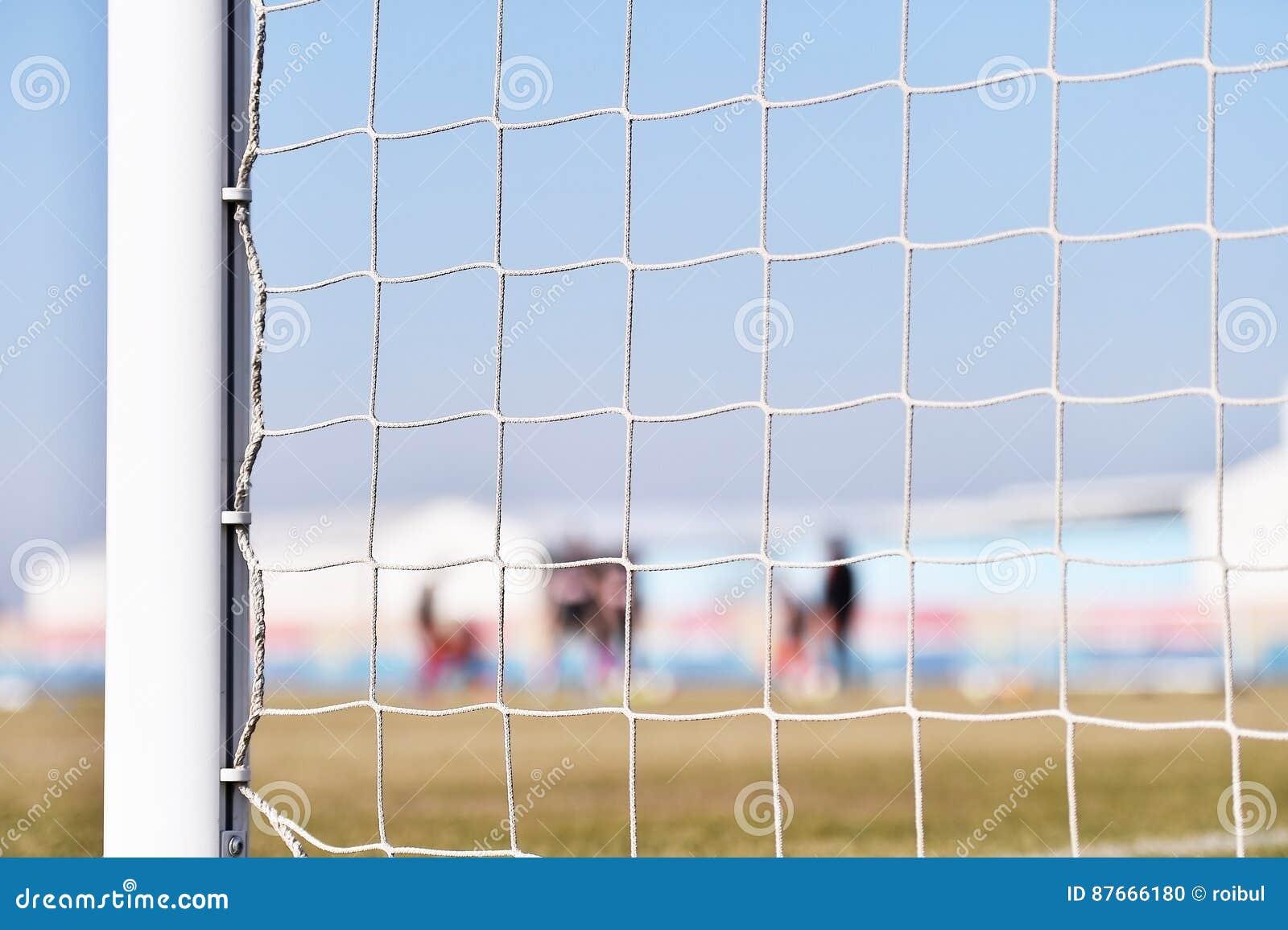Palo di calcio e formazione dei giocatori