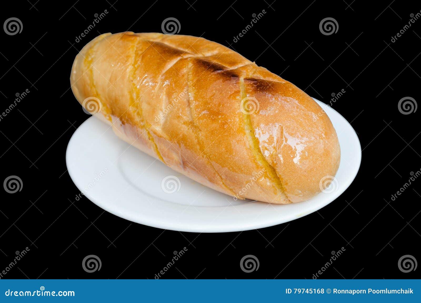 Pan del ajo y de la hierba aislado en el fondo negro con el clip
