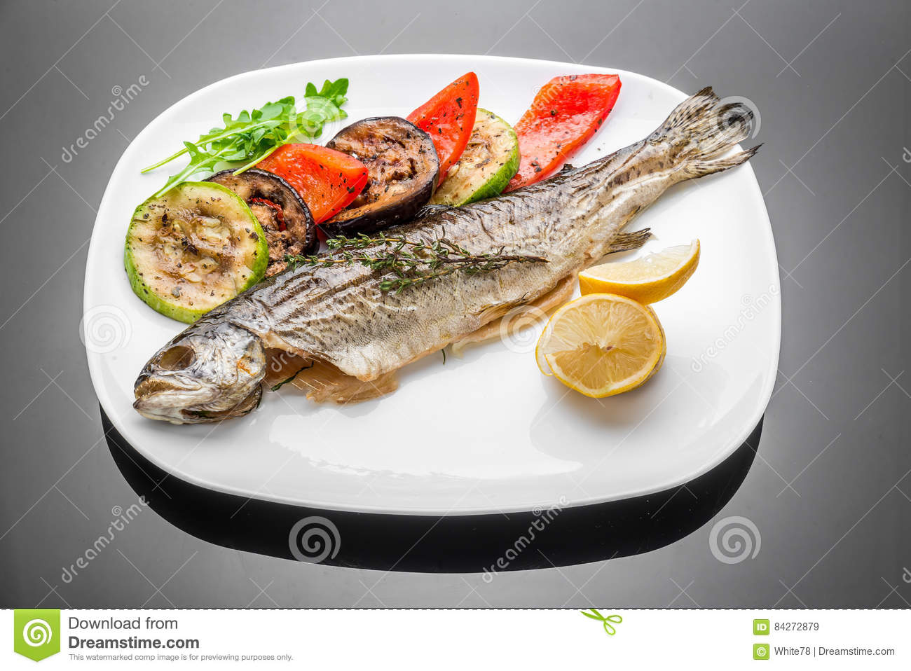 Pan fried grilled roasted cooked whole fish trout sea bass for Pan grilled fish
