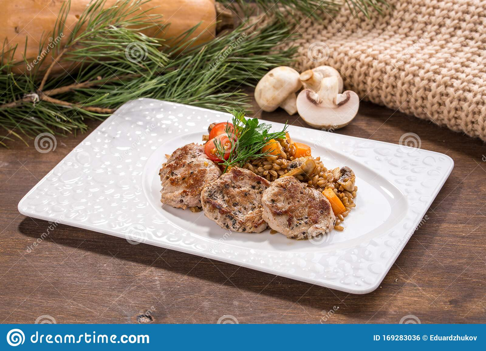 Pan Roasted Pork Tenderloin Medallions With Mushroom And Barley On Wooden Table Stock Photo Image Of Grilled Beef 169283036