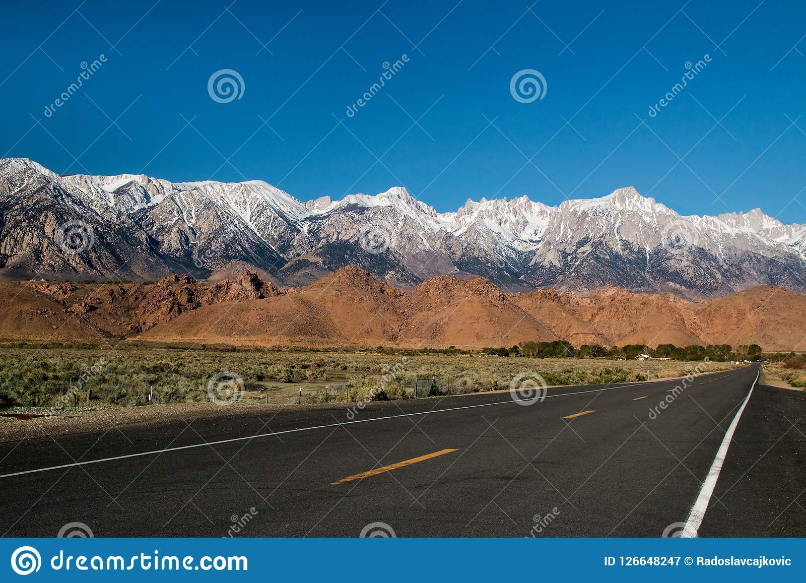 The Panamint Range high mountains shaping western wall of Death Valley desert, highway road trip scenery view in California