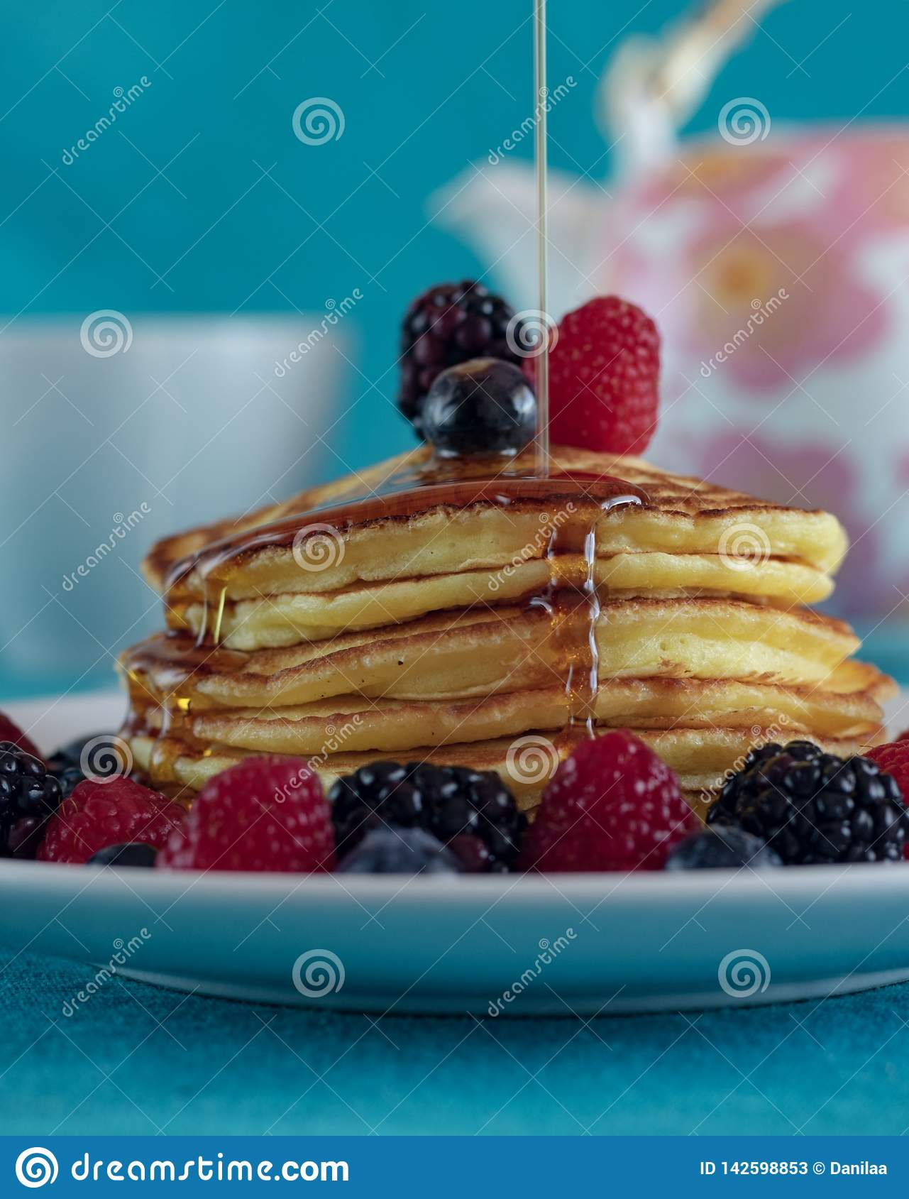 Pancake tower with a maple syrup waterfall.