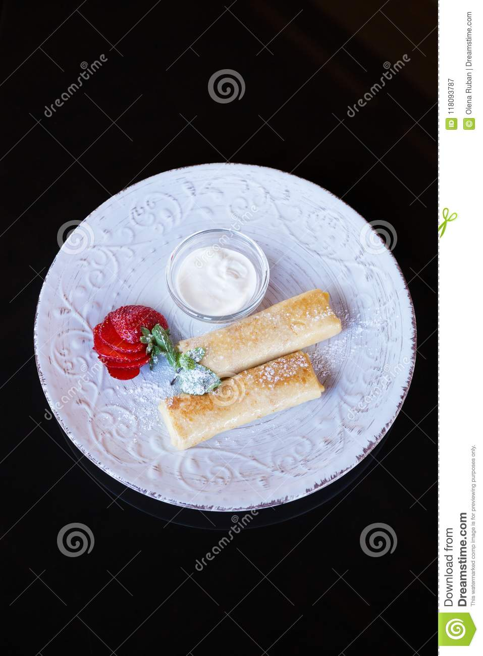 Pancakes on beautiful plate, space for text