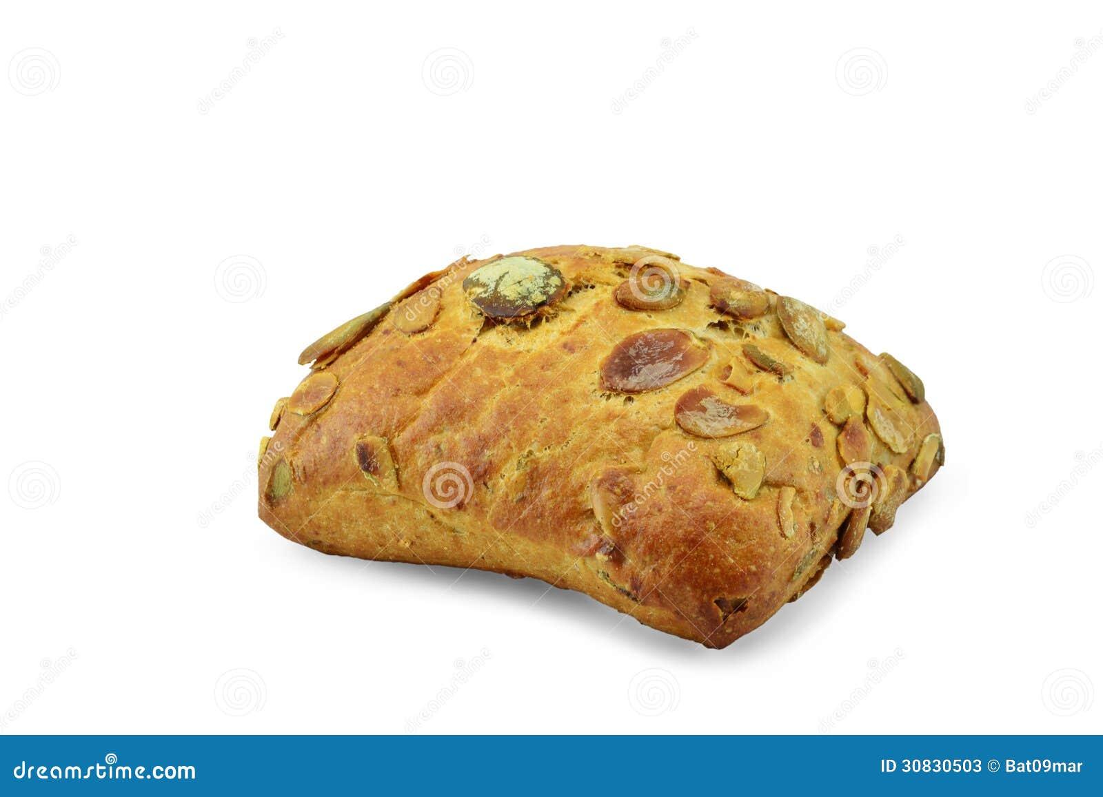 Pane con il seme di zucca su un fondo bianco