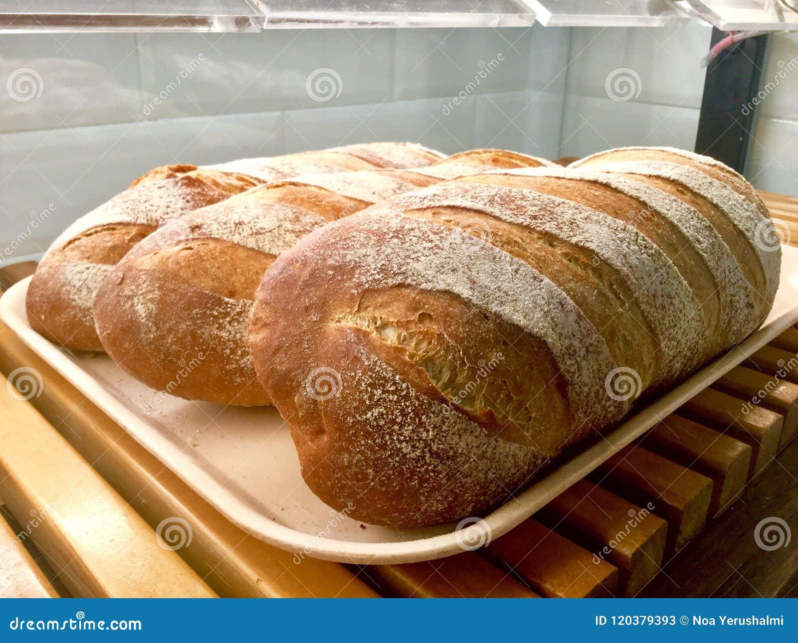 Panes del pan en bandeja Pan que anota