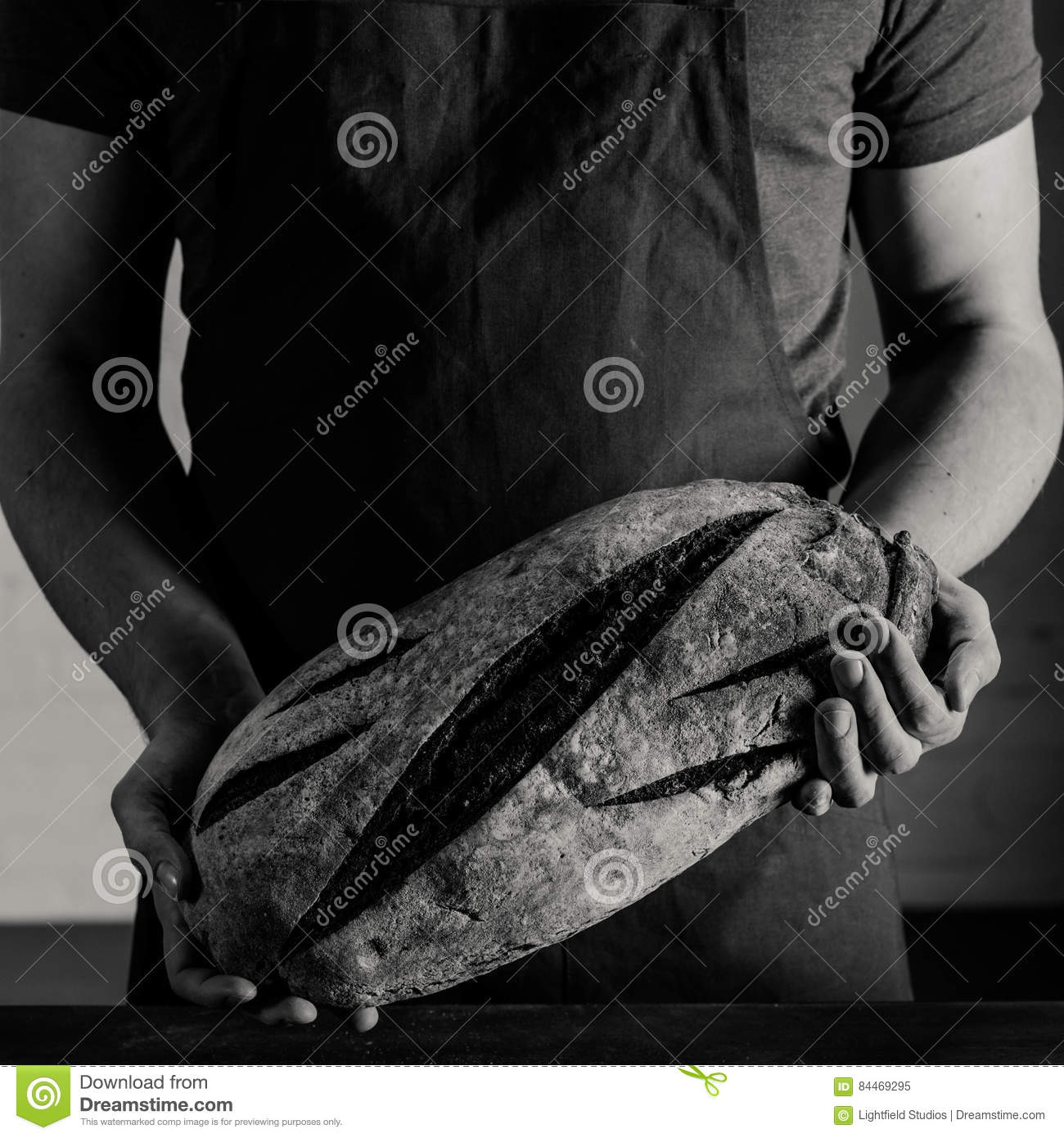 Panettiere Holding Bread