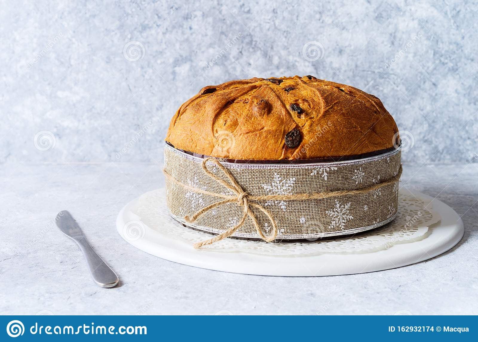 Panettone, typical christmas italian food, on rustic background