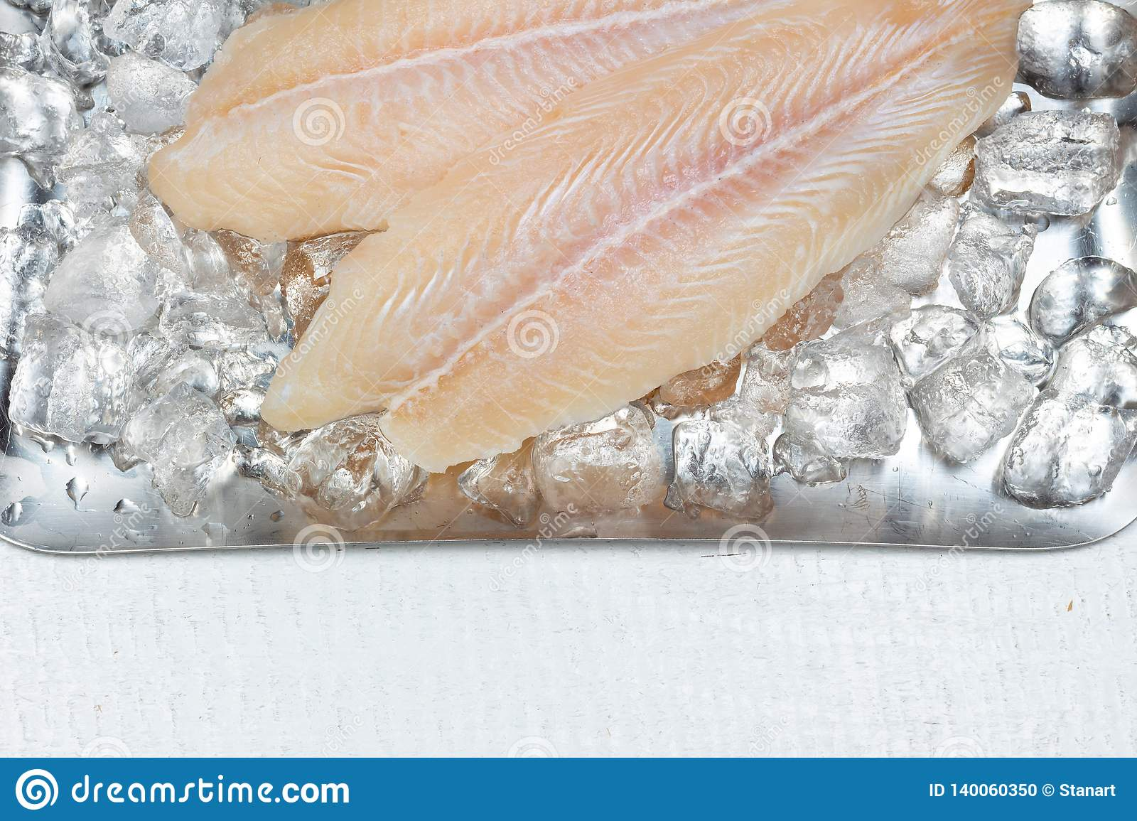 Pangasius basa fish fillet swai river cobbler bocourti fresh on ice with copy space