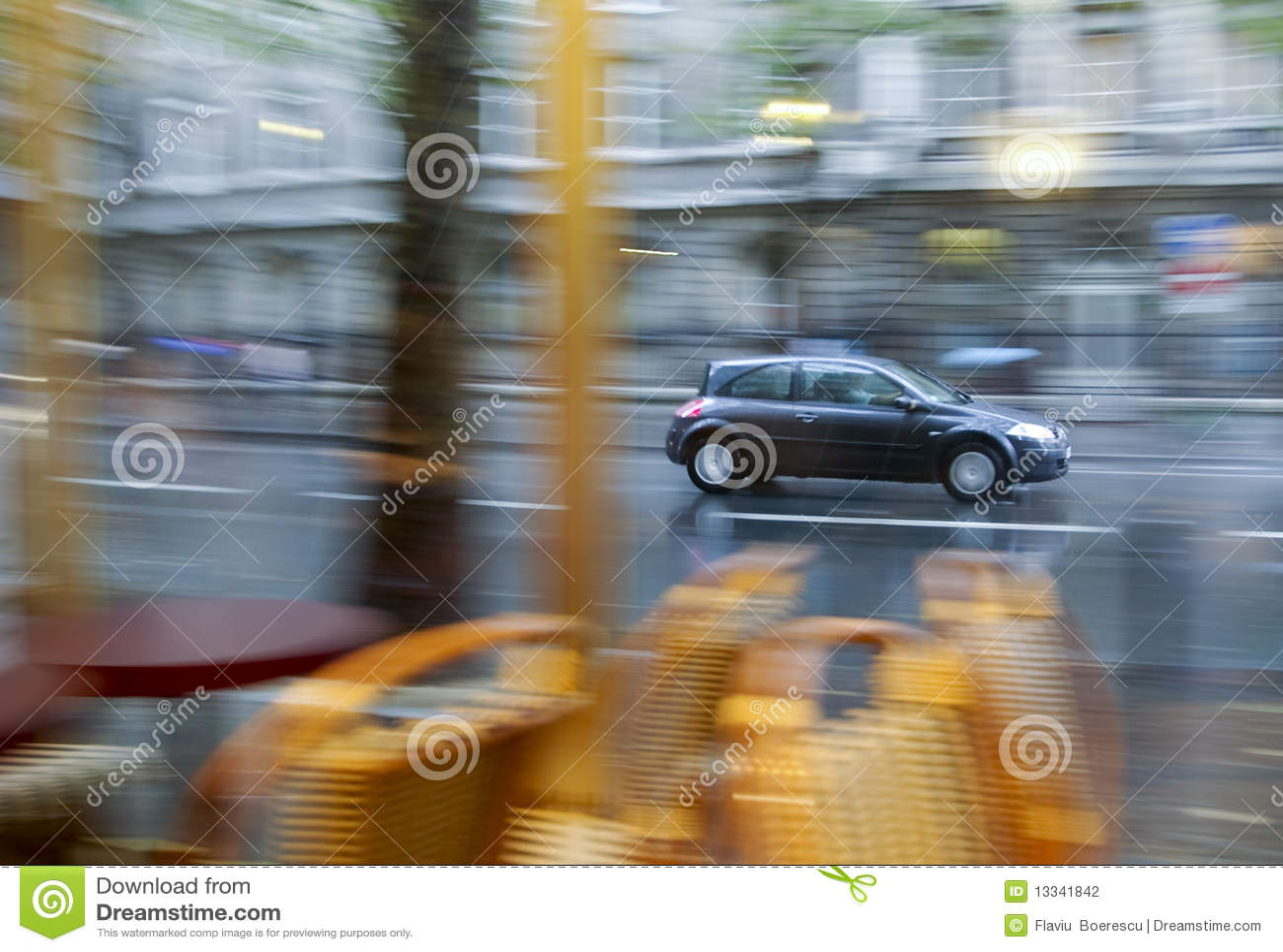 Panning effect on car rainy day wet asphalt views from bar interior