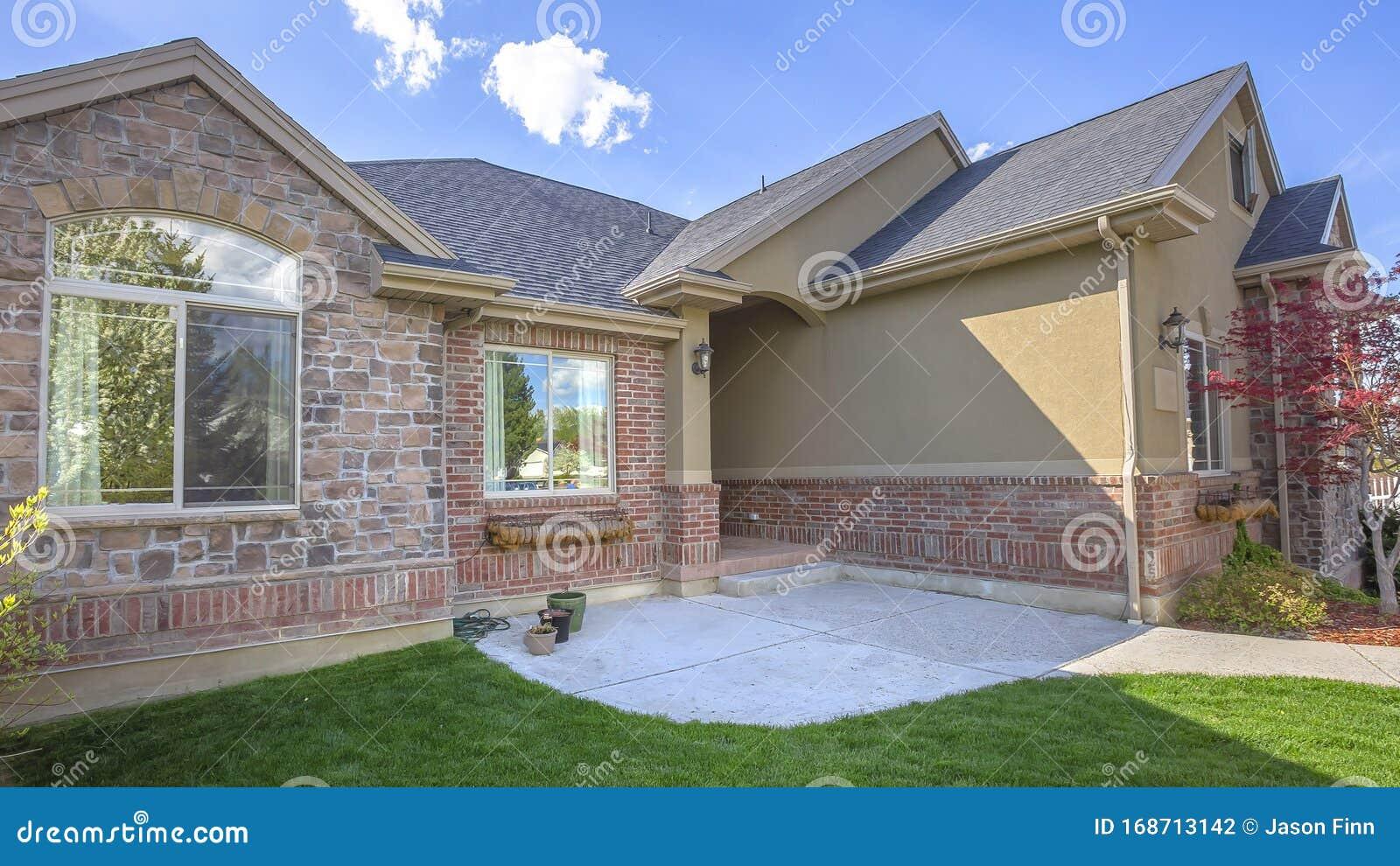 pano beautiful exterior home brick wall landscaped yard arched entryway pano beautiful exterior home brick 168713142