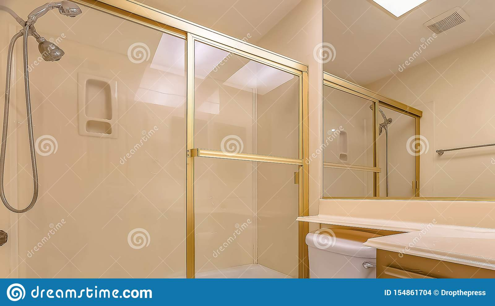 Panorama Bathroom Interior With Sink Cabinet And Toilet
