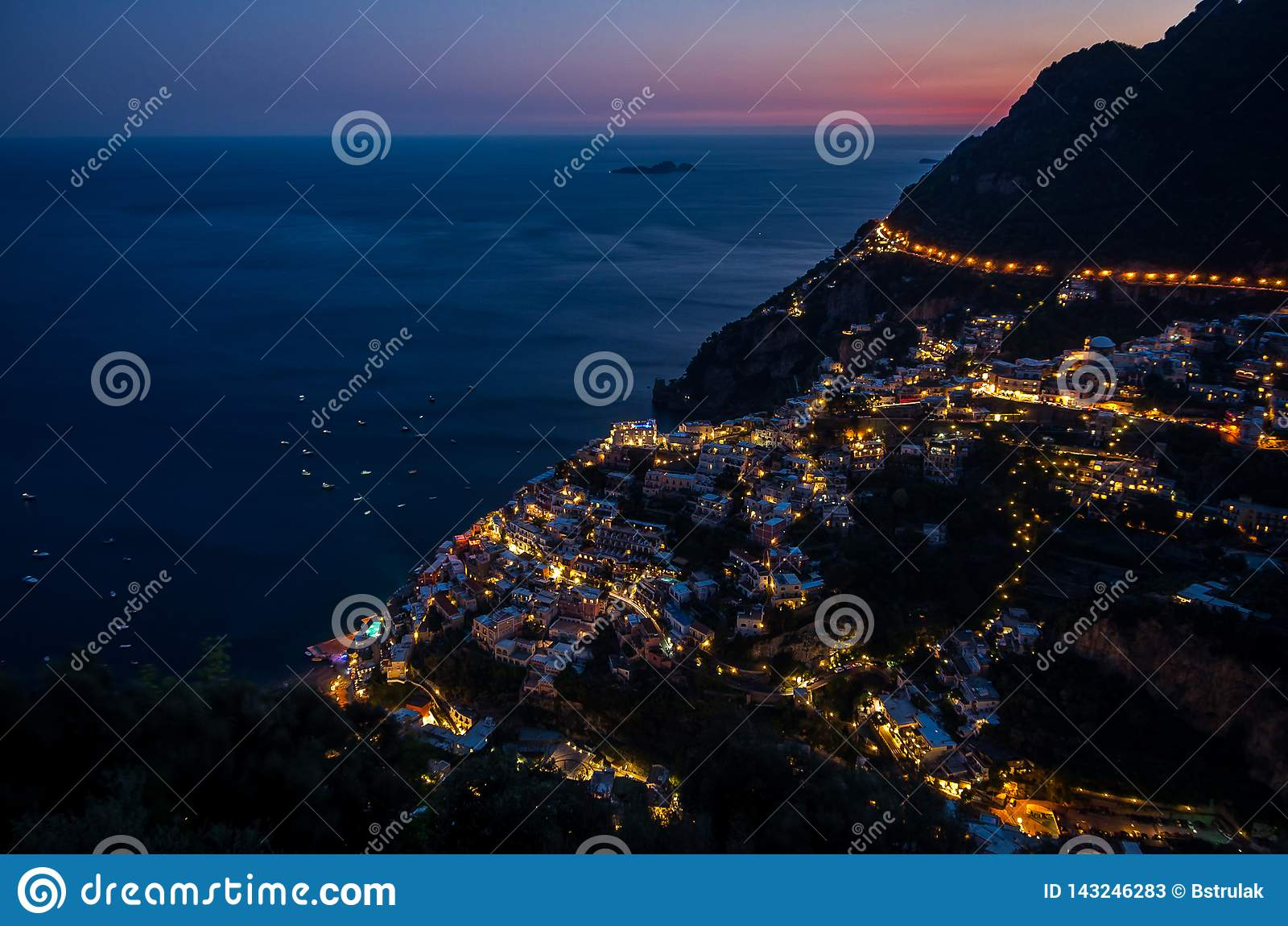 Panorama of beautiful coastal town - Positano by Amalfi Coast in Italy during sunset, Positano, Italy