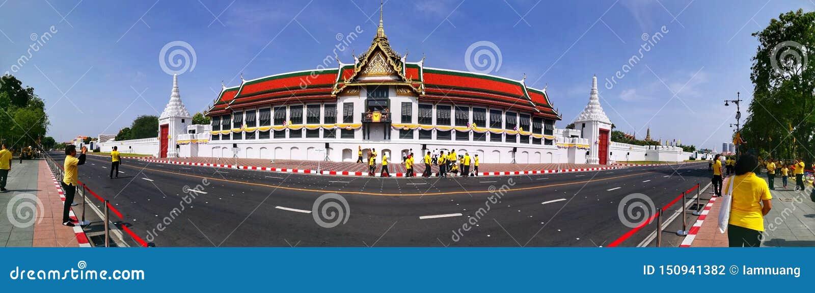 Panorama of Buddhaisawan Chapel and Thai in yellow shirtsin Bangkok during the moment of Thai Coronation days