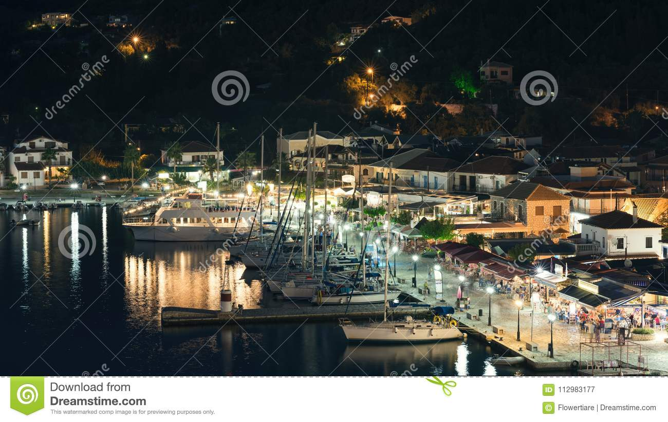 Panorama of the center of the night town of Sivota in the Greece.