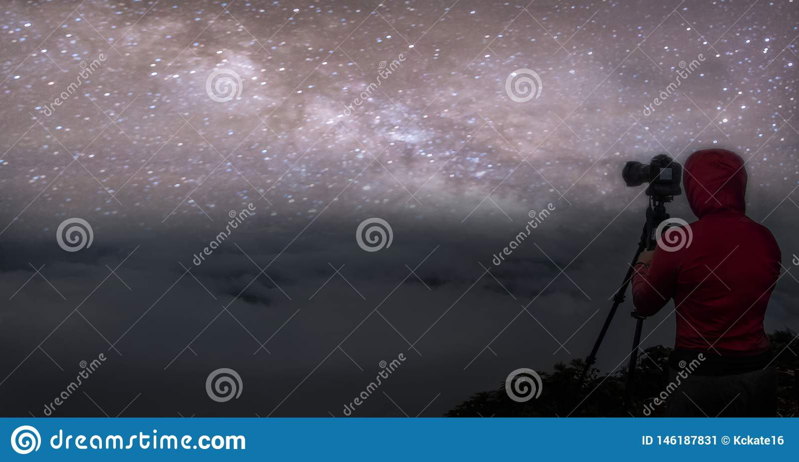 Panorama Colorful night sky with stars and silhouette of a standing man on the stone. Blue milky way with man on the mountain.