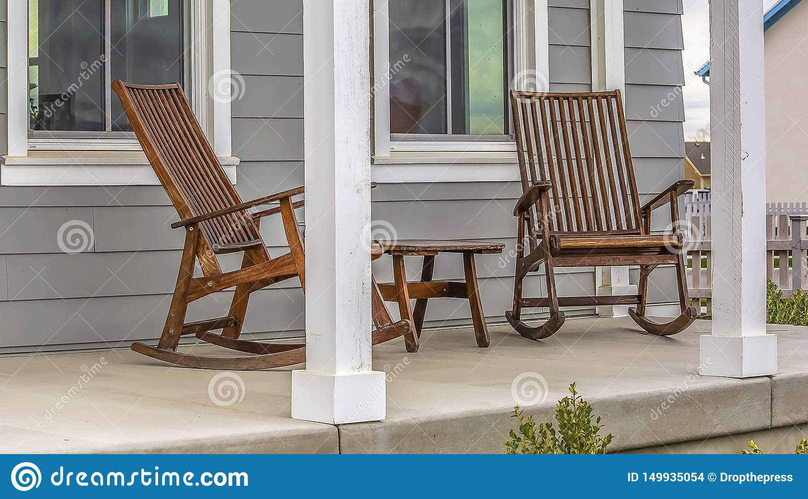 Magnificent Panorama Frame Front Porch Of A House With Brown Rocking Spiritservingveterans Wood Chair Design Ideas Spiritservingveteransorg