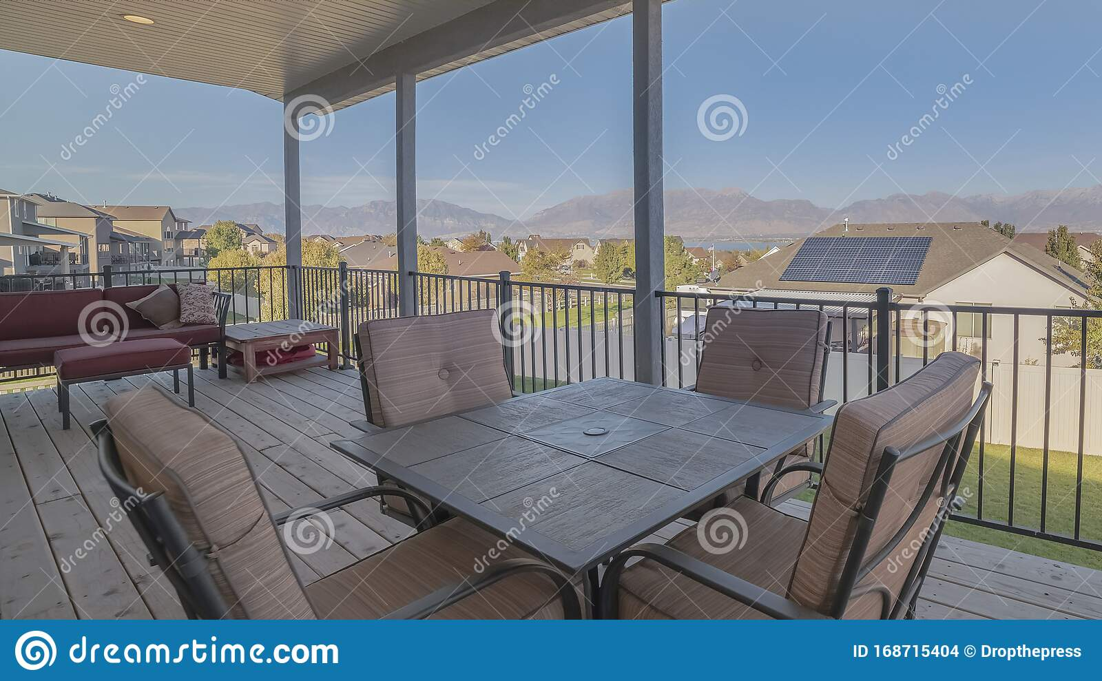 Panorama Frame Outdoor Dining Furniture On A Covered Patio ...