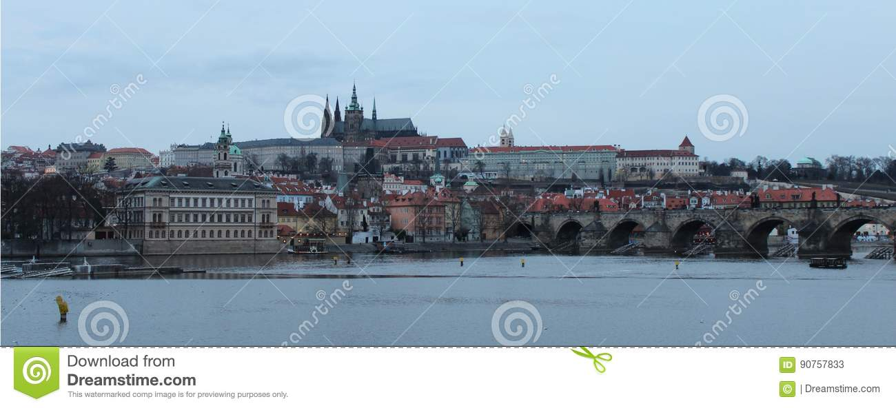 Panorama of the historical Prague with Castle, Vltava river and Charles Bridge.