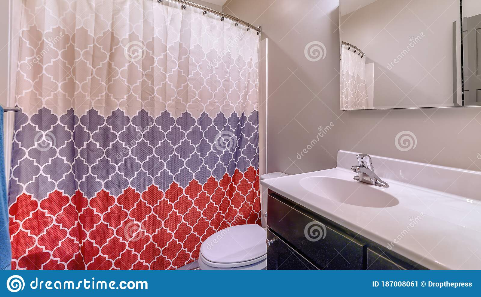 Panorama Home Bathroom With Toilet Vanity Area And Bathtub Conceled By Colorful Curtain Stock Image Image Of Mirror Room 187008061