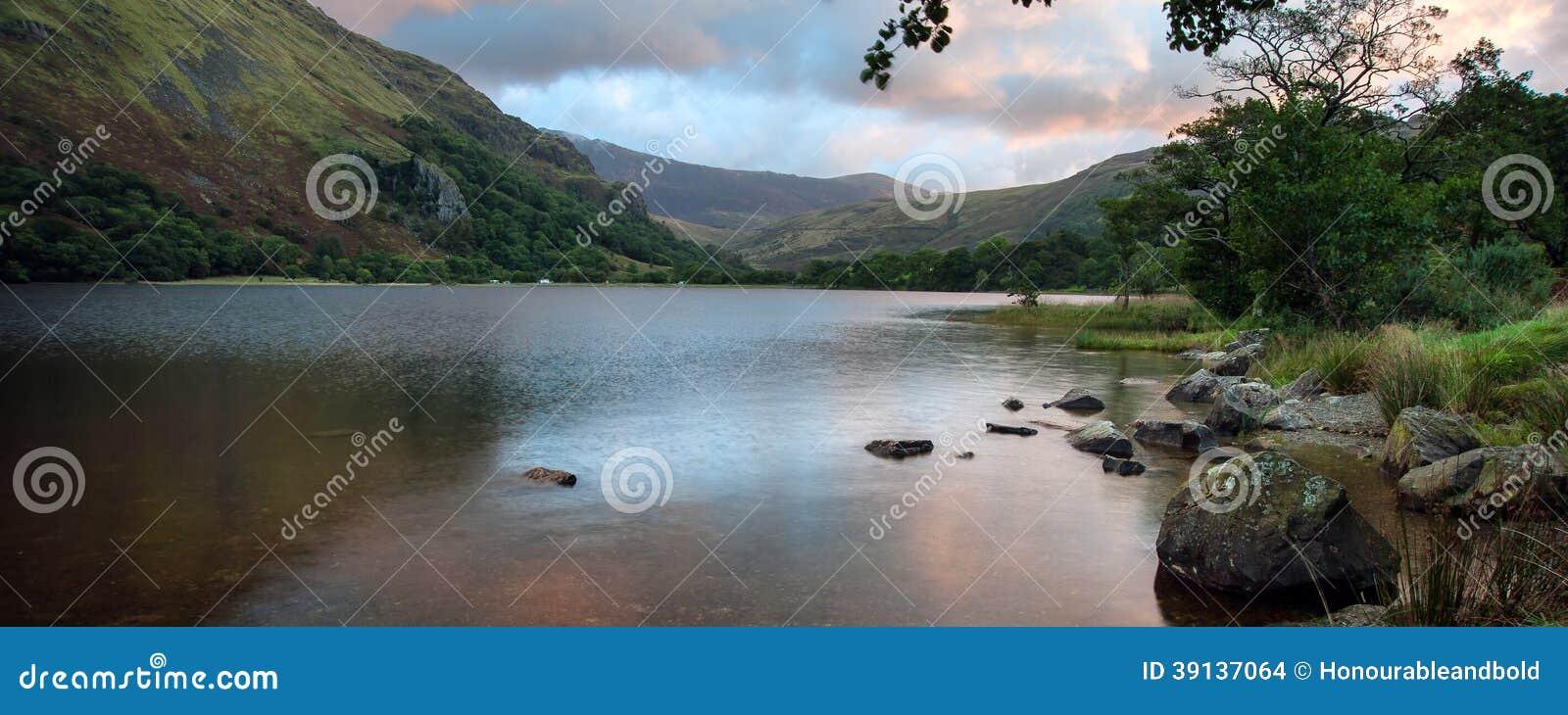 Panorama landscape sunrise over lake in mountains