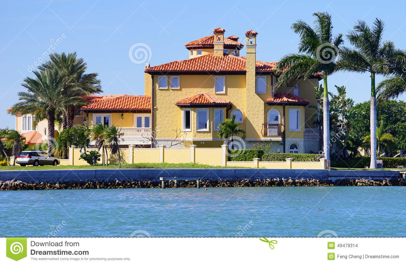 Panorama of luxury beach house with boat dock stock photo for Luxury beach houses