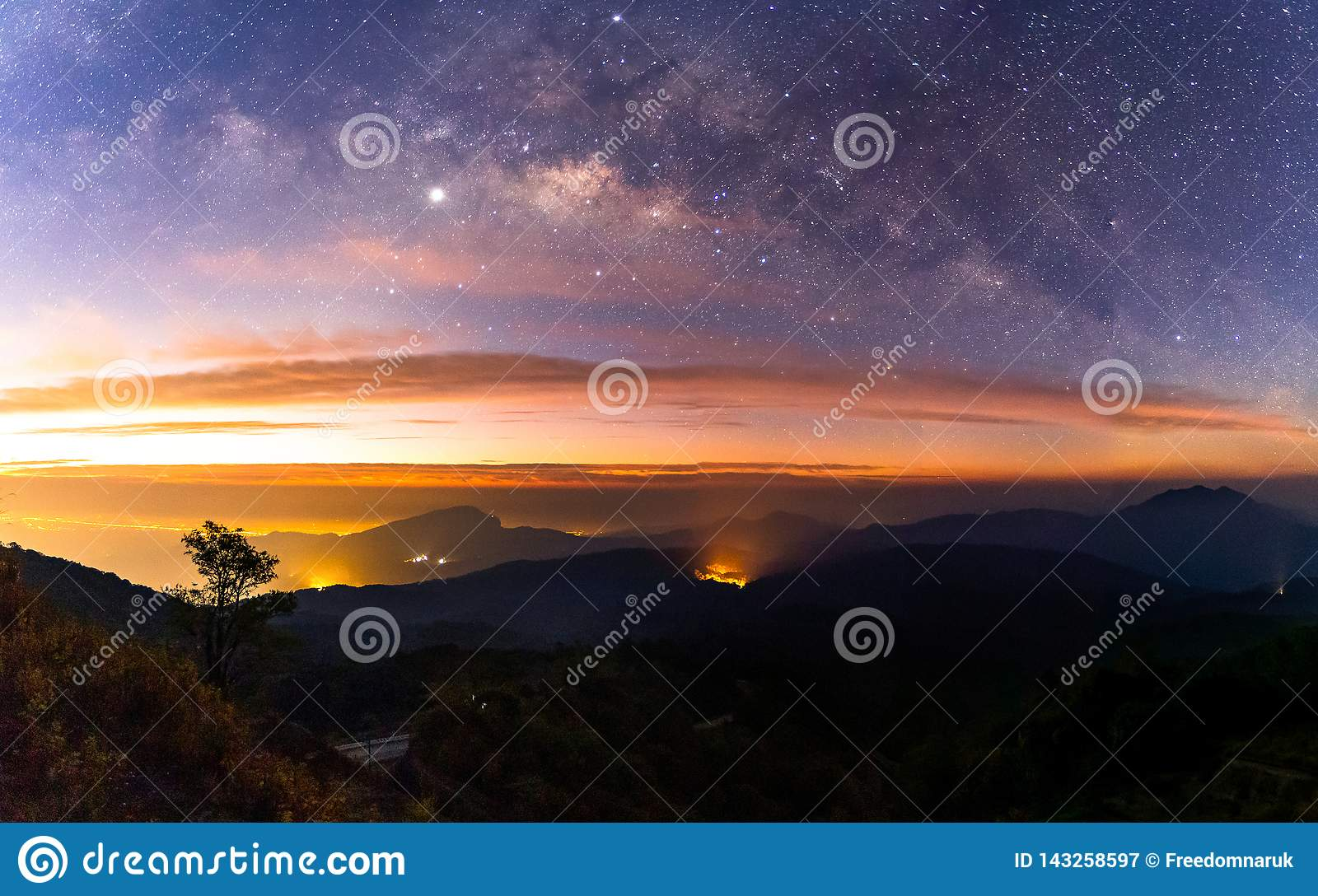 Panorama Milky Way Galaxy with light city at Doi inthanon Chiang mai, Thailand
