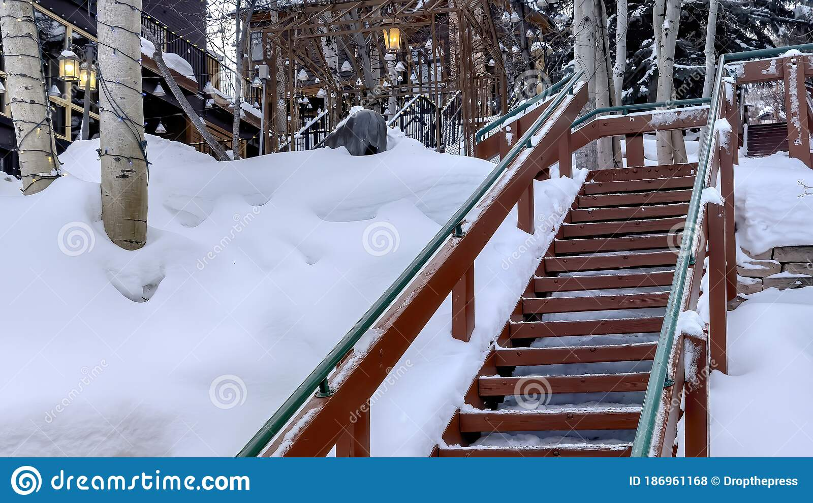 Image of: Panorama Outdoor Stairs On Snowy Slope Against Buildings And Trees On Cloudy Winter Day Stock Photo Image Of Snowy Cloudy 186961168
