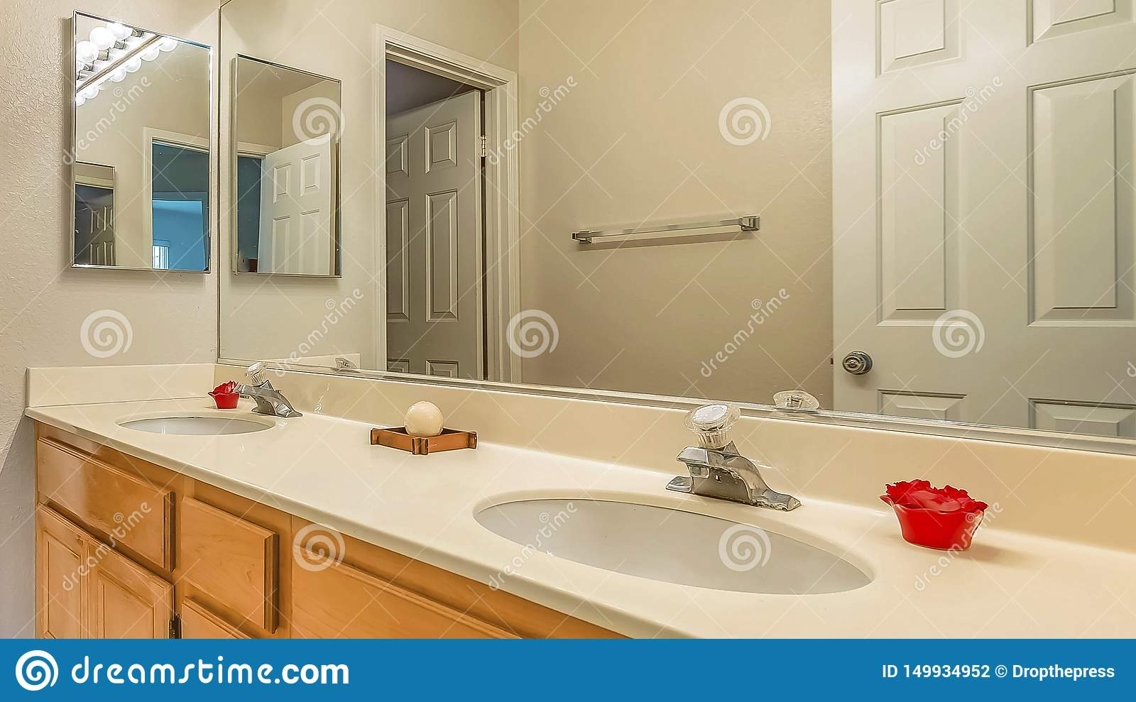 Panorama Vanity With Double Sink And Wood Cabinets Inside The Small Bathroom Of A Home Stock Photo Image Of Shower Residential 149934952