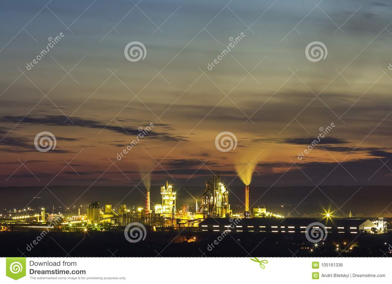 Panorama view of cement plant and power sation at night in Ivano