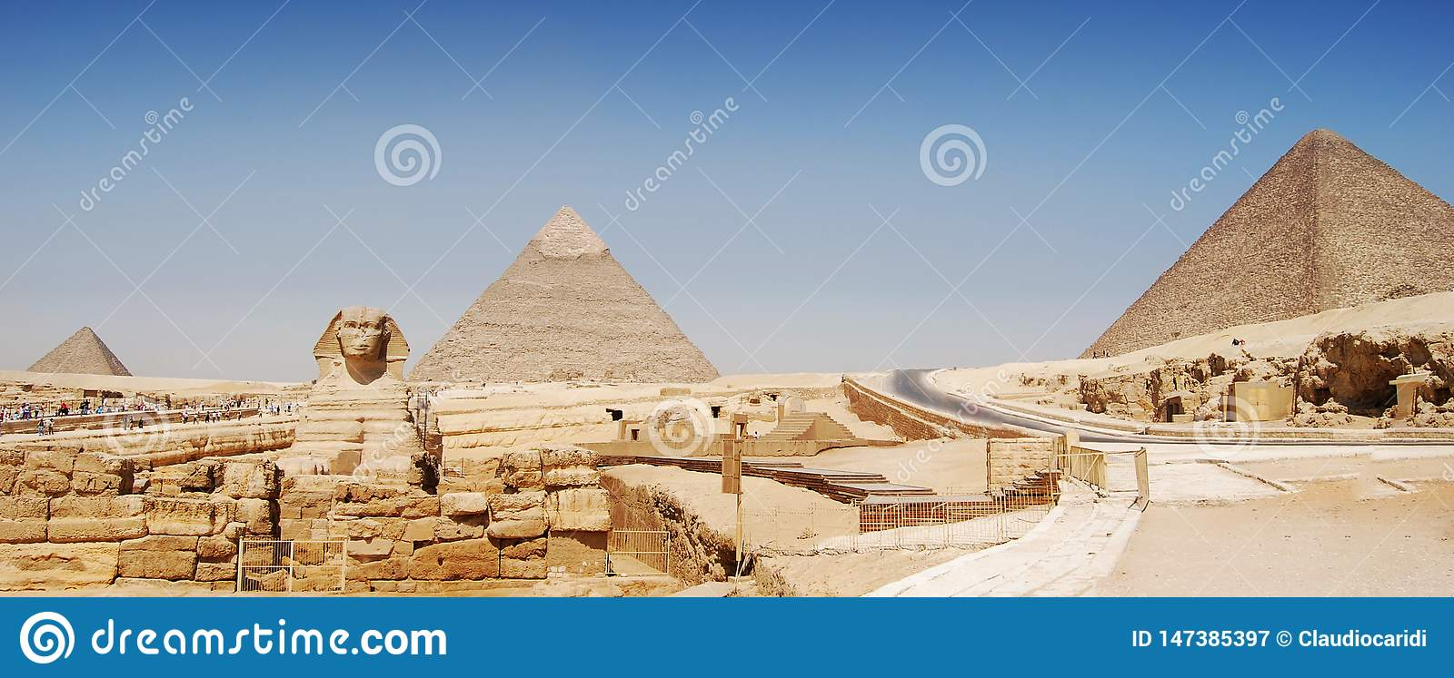Panorama view of Giza in Cairo, the great pyramyd of Cheops, the pyramids of Kefren and Micerinos, the Sphinx