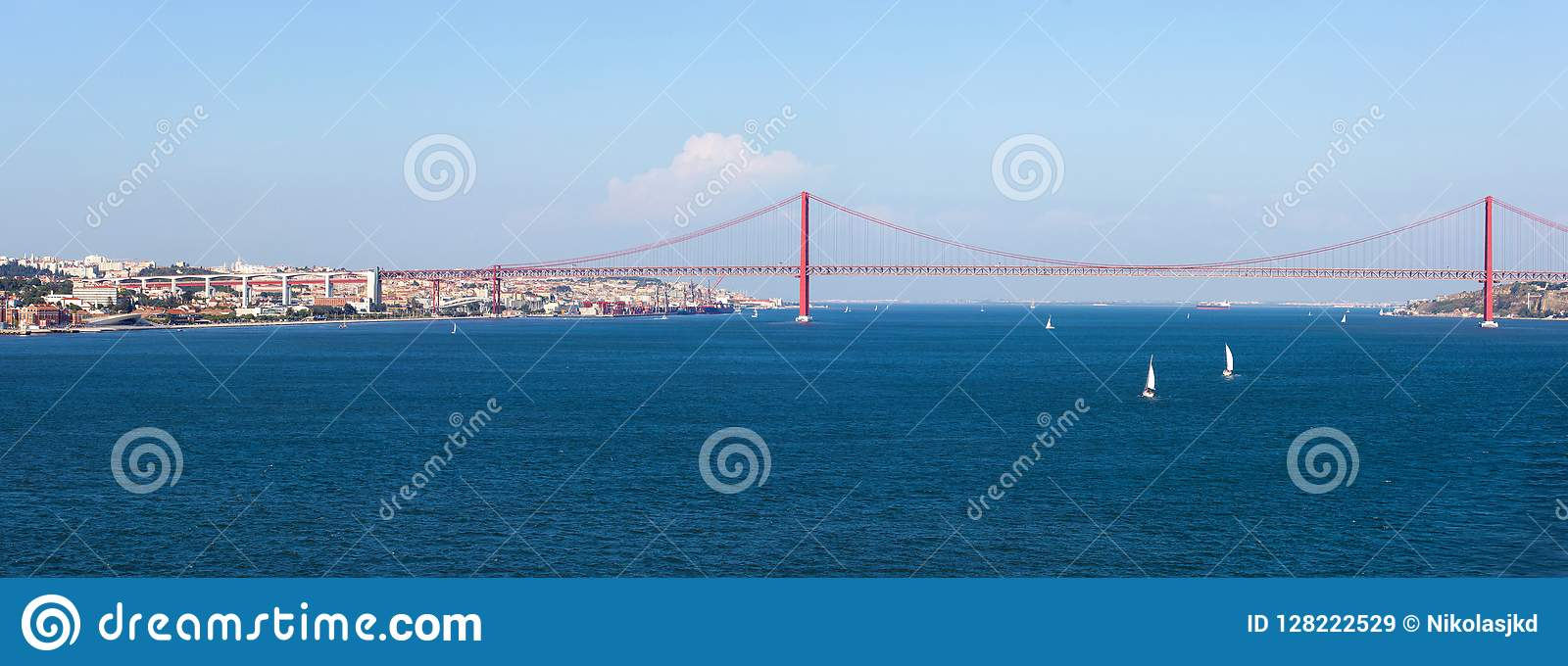 Panorama view over the 25 de Abril Bridge. The bridge is connecting the city of Lisbon to the municipality of Almada