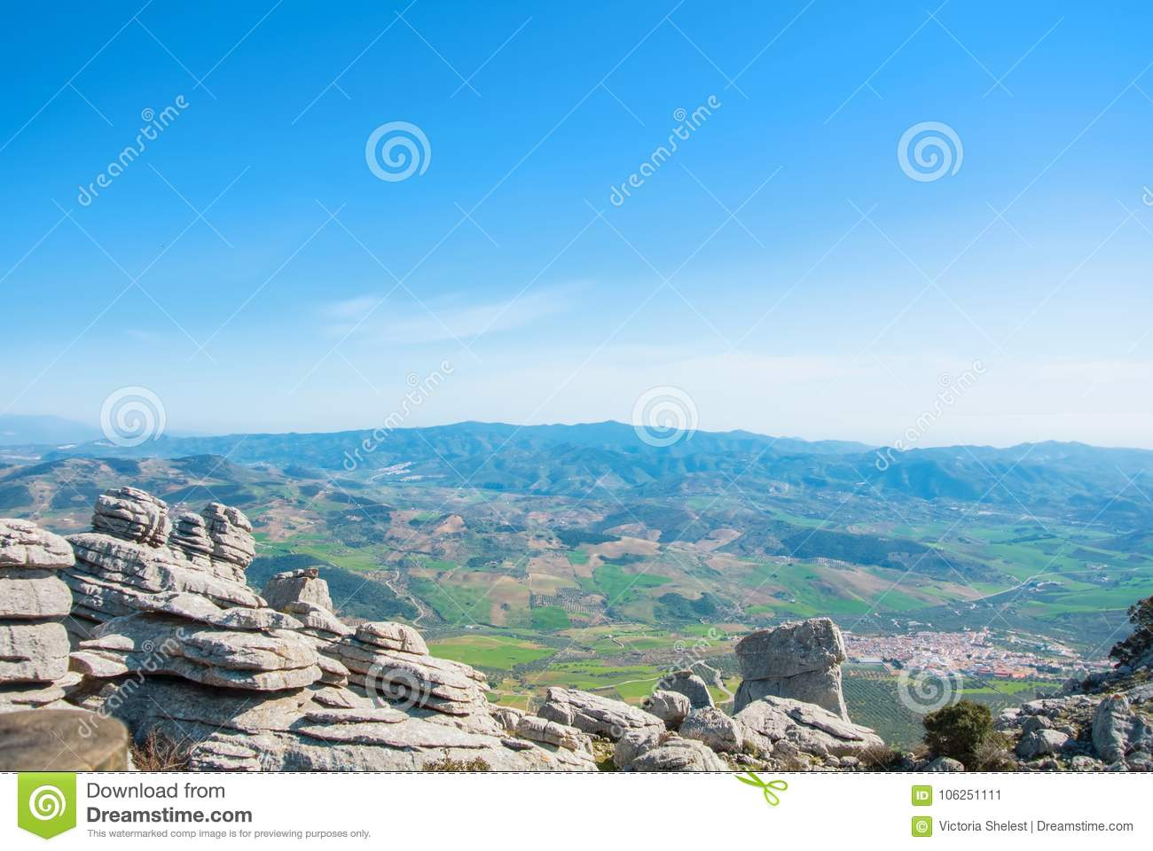 Panoramic aerial top view to a valley, colorful fields and a typical white village from view point at El Torcal natural park on s