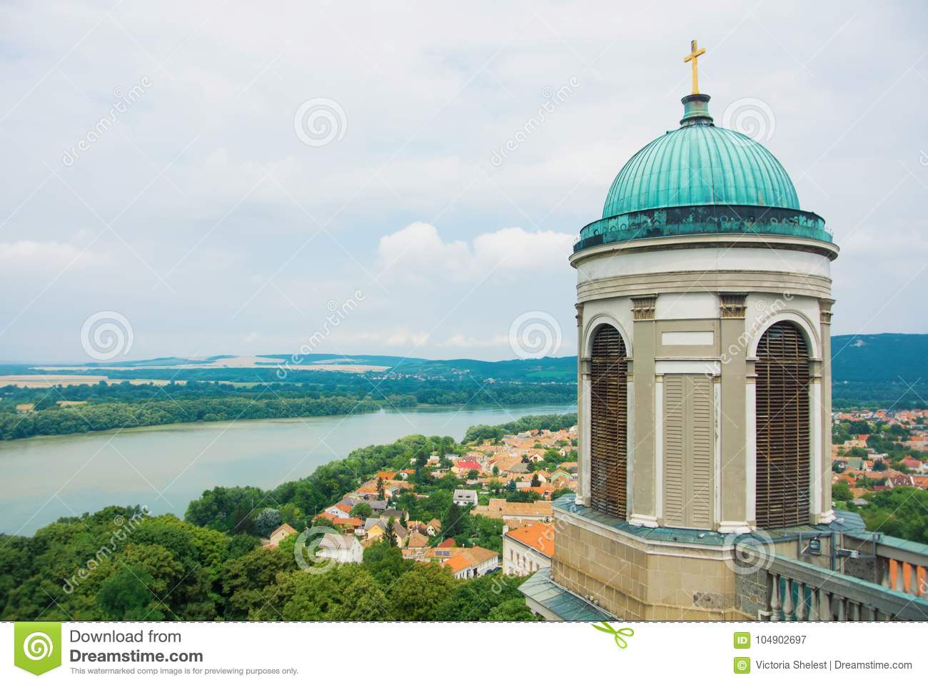 Panoramic aerial view over the roofs of Esztergom town near Budapest, Danube river and a tower of Esztergom Cathedral at the fore
