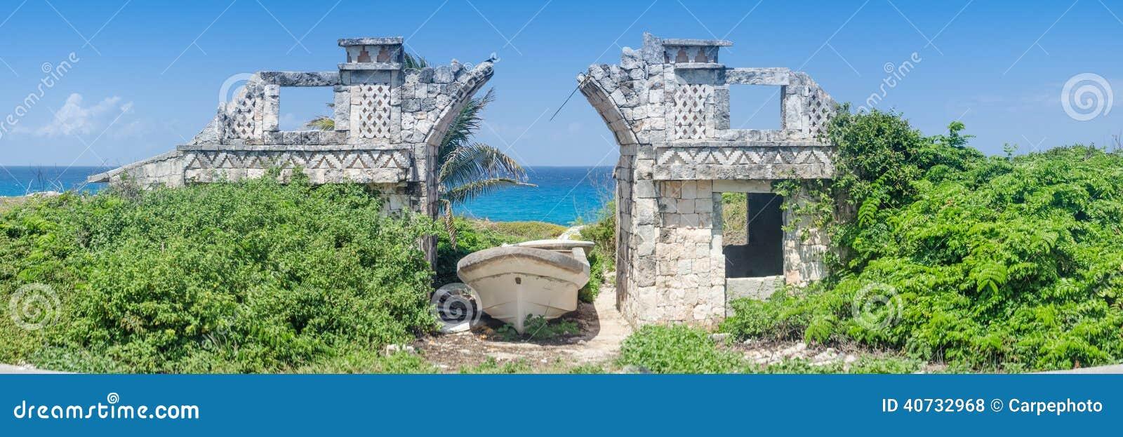 Panoramic of old ruins, boat, and ocean.