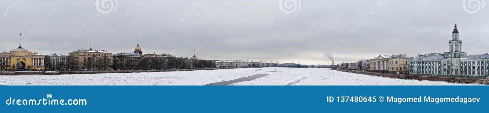 Ice on Neva river panorama. Panoramic shot of ice on Neva river between Palace and Annuncuation bridges, Saint Petersburg, Russia royalty free stock photo