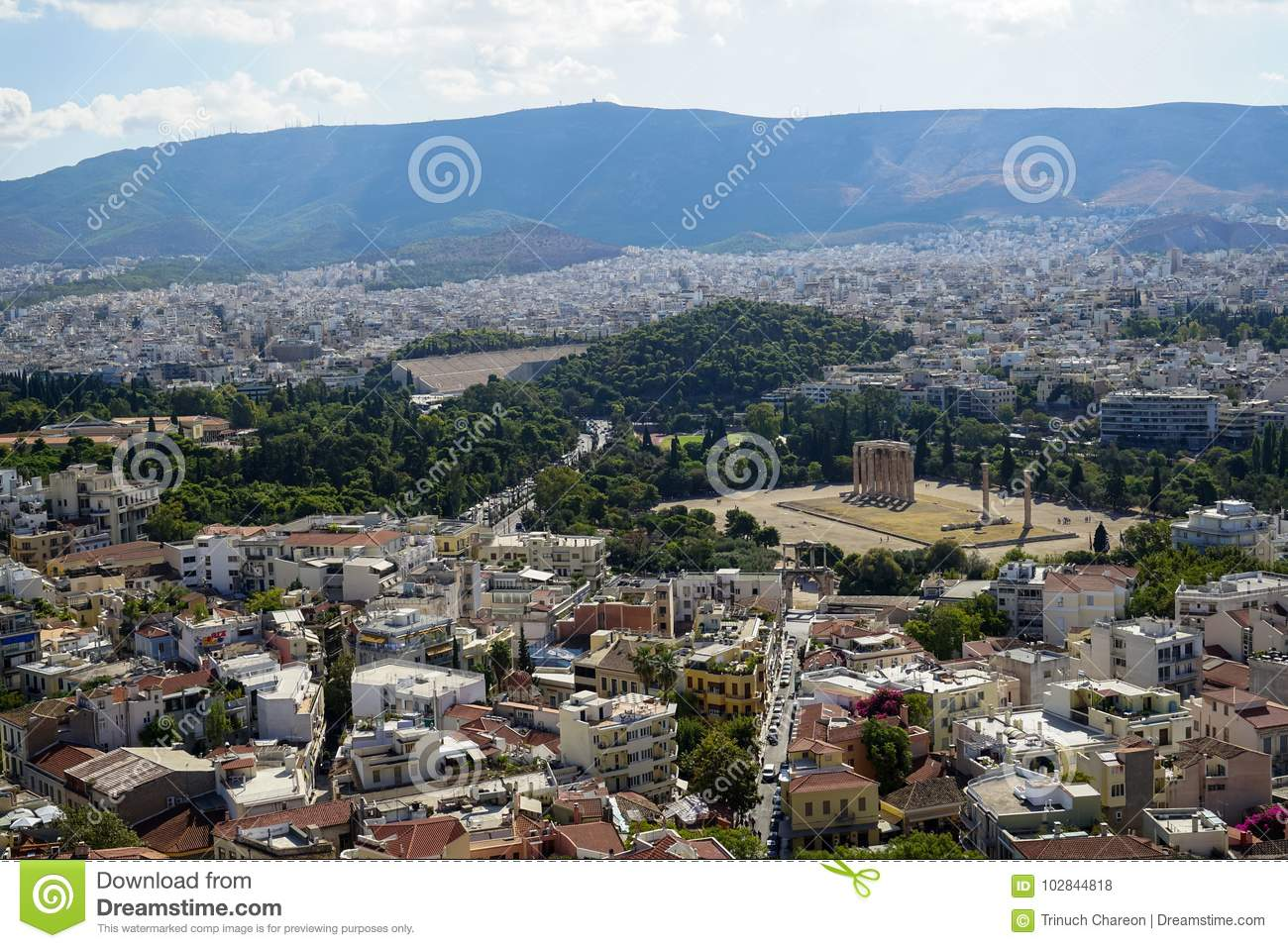 Panoramic view of beautiful Athens city from Acropolis seeing ancient ruin, building architecture, urban street, trees, mountain