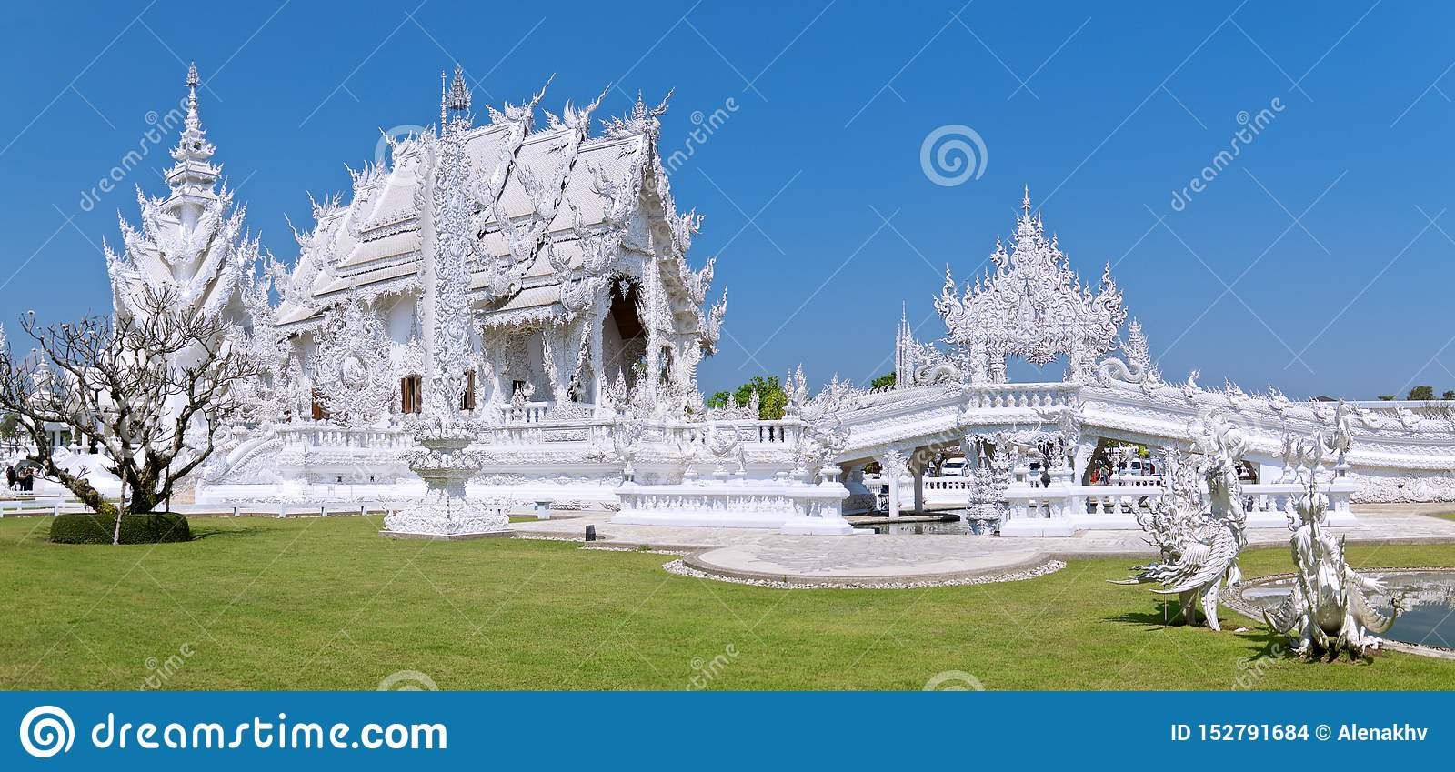 Panoramic view of the famous amazing White Buddhist temple against the blue cloudless sky
